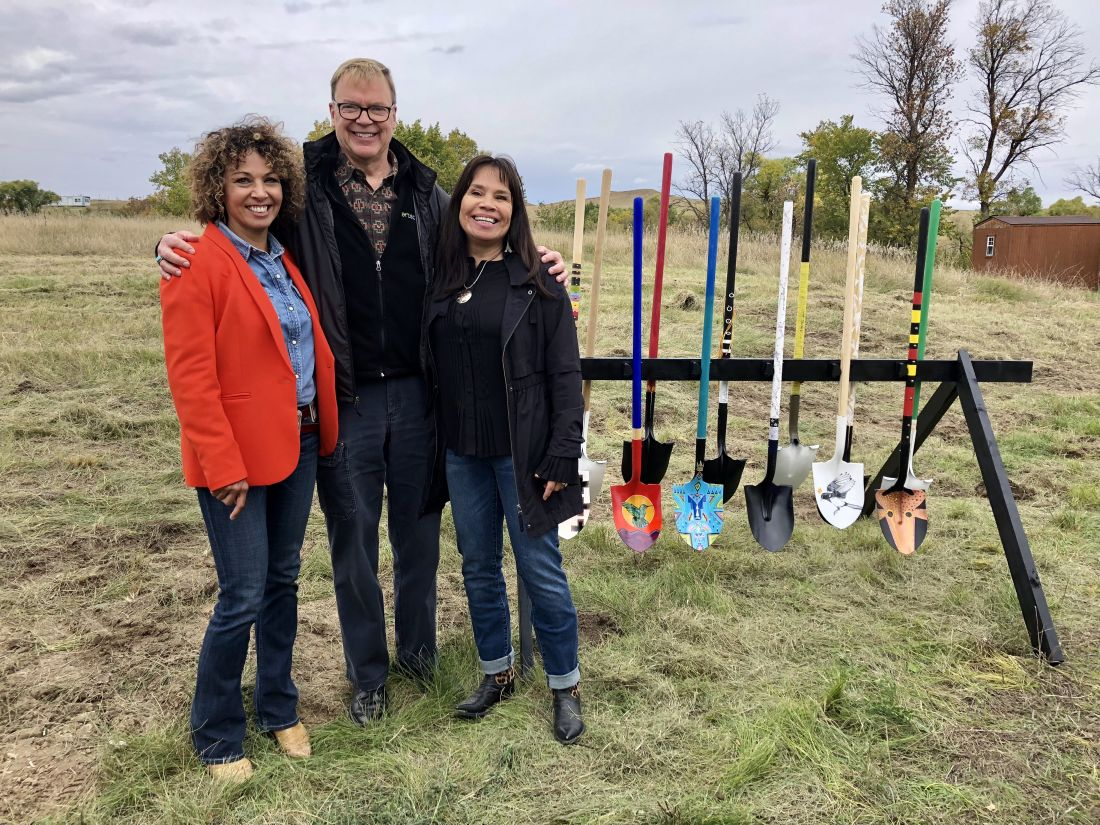 From Left to Right: Lakota Funds Executive Director Tawney Brunsch, Artspace President Kelley Lindquist, and First Peoples Fund President Lori Pourier pose with artist-designed shovels at the Oglala Lakota Artspace Groundbreaking. September 2018.
