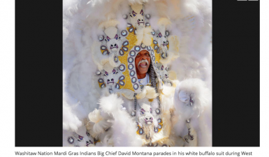 Washitaw Nation Mardis Gras Indian Big Chief David Montana parades in his white buffalo suit