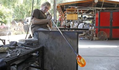Artist Gavin Heath demonstrates the art of glass blowing