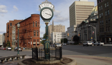 view of of the city of utica and famous clock
